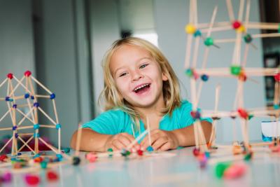 Little girl making geometric shapes from sticks