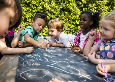 children drawing outdoors